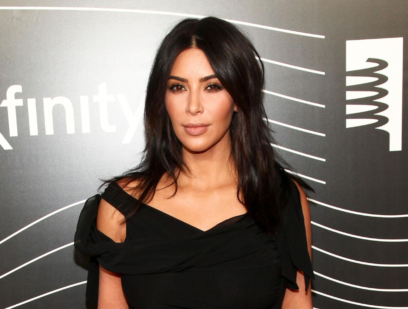"FILE - In this May 16, 2016 file photo, Kim Kardashian West attends the 20th Annual Webby Awards in New York. Kardashian who has been laying low in a New York City apartment building since her robbery at gunpoint in Paris in October, breaks her silence in a new teaser for the family's reality show, ""Keeping Up with the Kardashians,"" returning in March. (Photo by Andy Kropa/Invision/AP, File)"