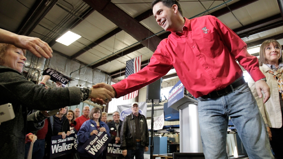 Wisconsin Gov. Scott Walker shakes hands with supporters after a campaign rally at Dane Manufacturing in Dane, Wis., Tuesday, April 15, 2014. Walker officially launched his re-election campaign Tuesday with a series of rallies across Wisconsin. (AP Photo/Wisconsin State Journal, M.P. King)