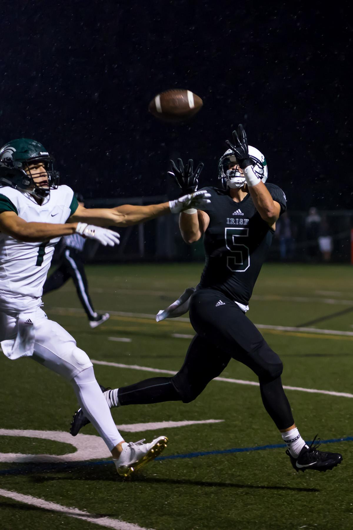 Sheldon's Patrick Herbert (#5) catches a pass. On a rainy Monday evening, Sheldon defeated West Salem at home 41 – 7. The game had been postponed until Monday, September 18, due to unhealthy levels of smoke in the air caused by nearby forest fires. Photo by Kit MacAvoy, Oregon News Lab