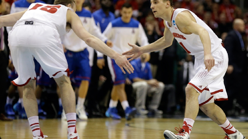 Wisconsin forward Sam Dekker, left, and guard Ben Brust celebrate during the second half of a second-round game against the American in the NCAA college basketball tournament Thursday, March 20, 2014, in Milwaukee. (AP Photo/Jeffrey Phelps)