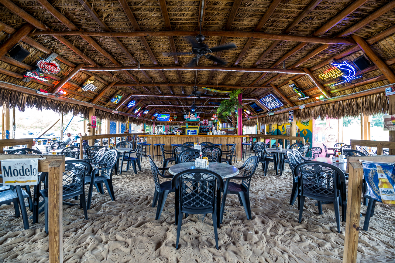 PLACE: Pirate's Cove Tropical Bar & Grill / ADDRESS: 4609 Kellogg Avenue (East End) / Pirate's Cove is Key West-inspired and located at the Four Seasons Marina. The festive spot offers an open patio with excellent water views, live music and entertainment, and a broad menu featuring seafood and American fare. You may even spot a friendly pirate wandering around if you're lucky. / Image: Catherine Viox // Published: 7.18.19