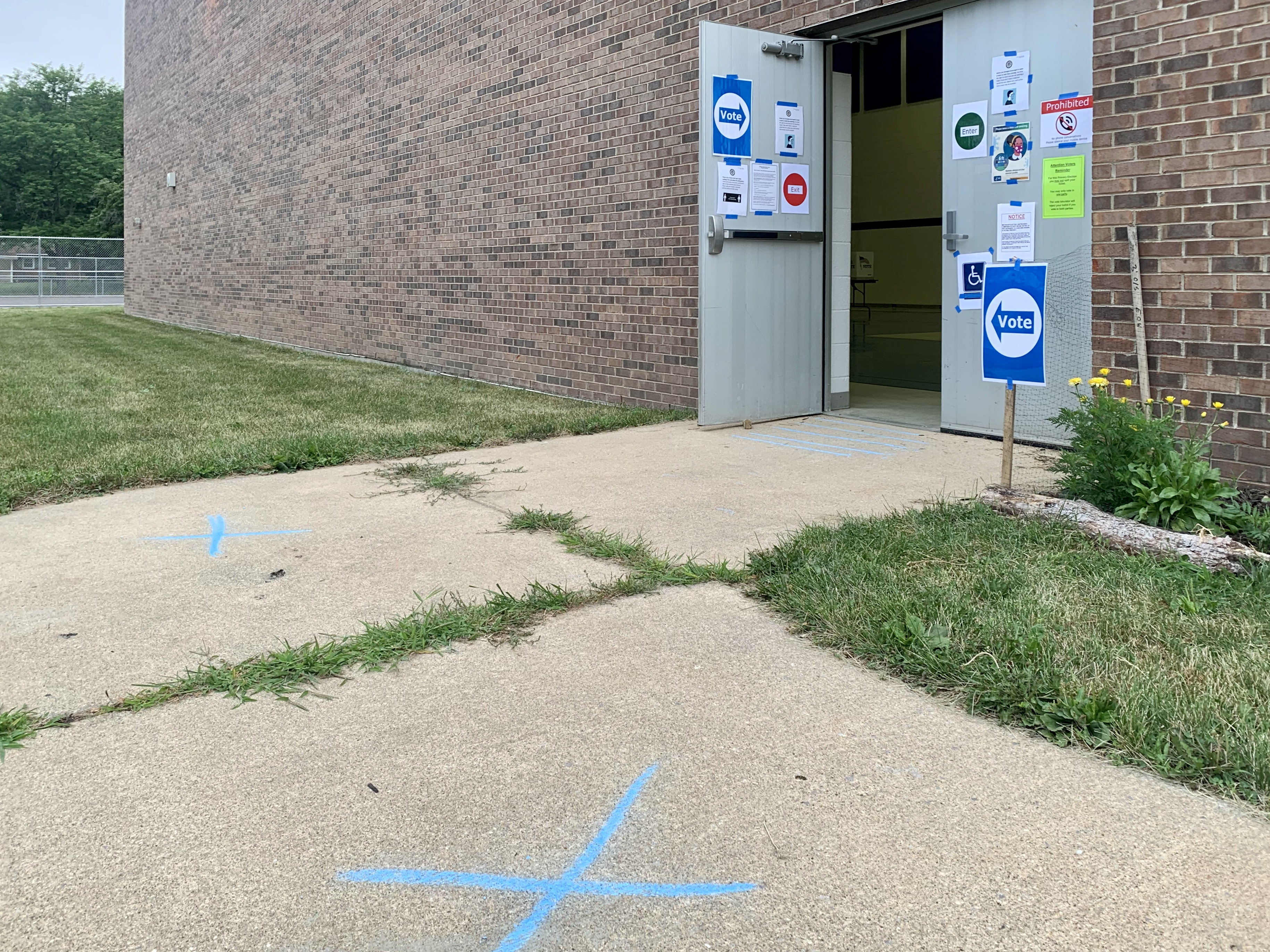 Polling places, with reminders to maintain social distancing because of the COVID-19 pandemic, opened across Michigan at 7 a.m. Tuesday for the state's primary election. This one is at Arcadia Elementary School on Aug. 4, 2020. (WWMT/Hannah Knowles)