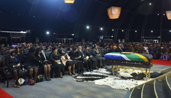 Family members and guests attend the funeral service for former South African President Nelson Mandela in a makeshift tent in Qunu, South Africa, Sunday, December 15, 2013.Click the photo for the full story.
