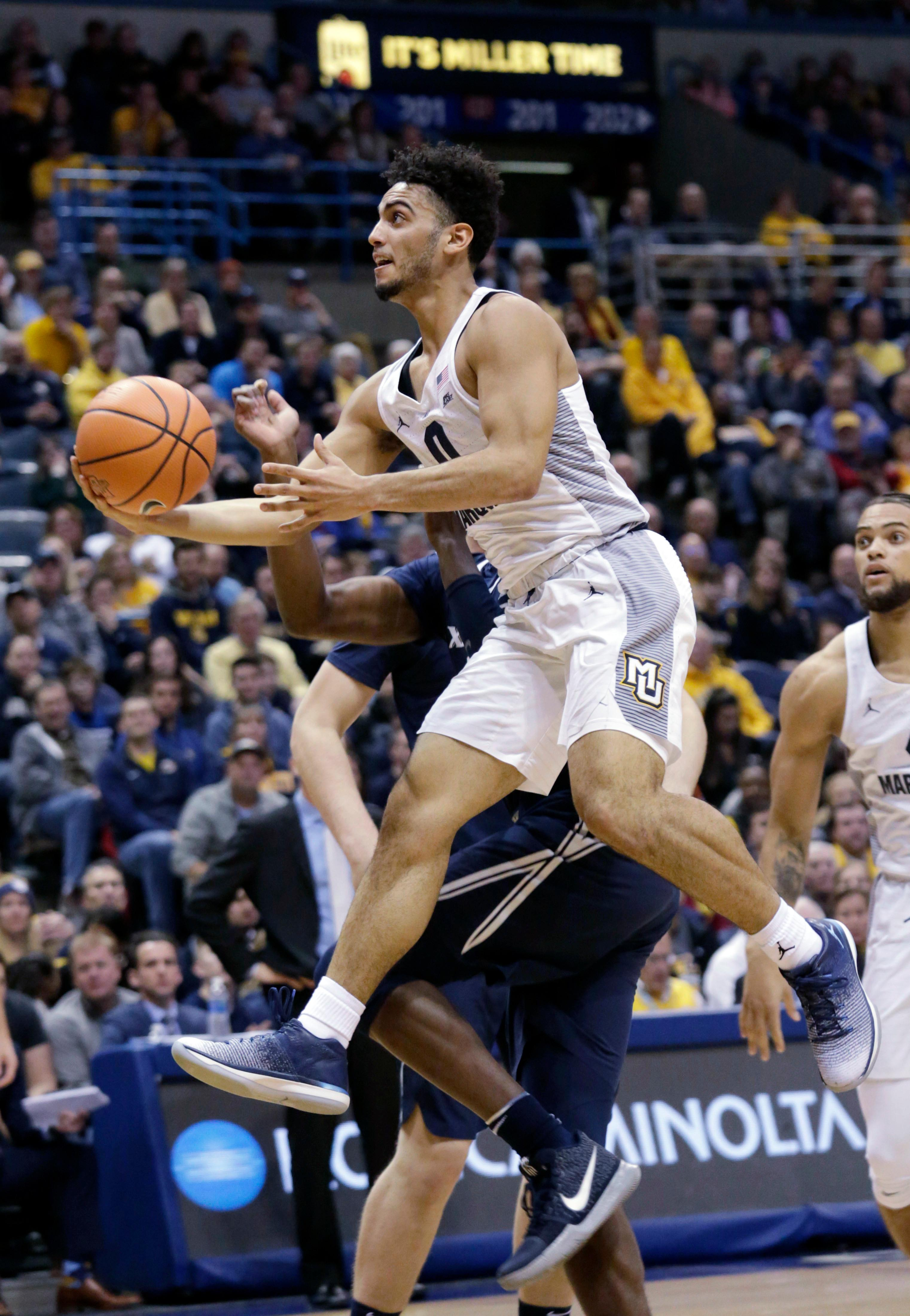 Marquette guard Markus Howard drives to the basket against Xavier during the first half of a basketball game, Wednesday, Dec. 27, 2017, in Milwaukee. (AP Photo/Darren Hauck)