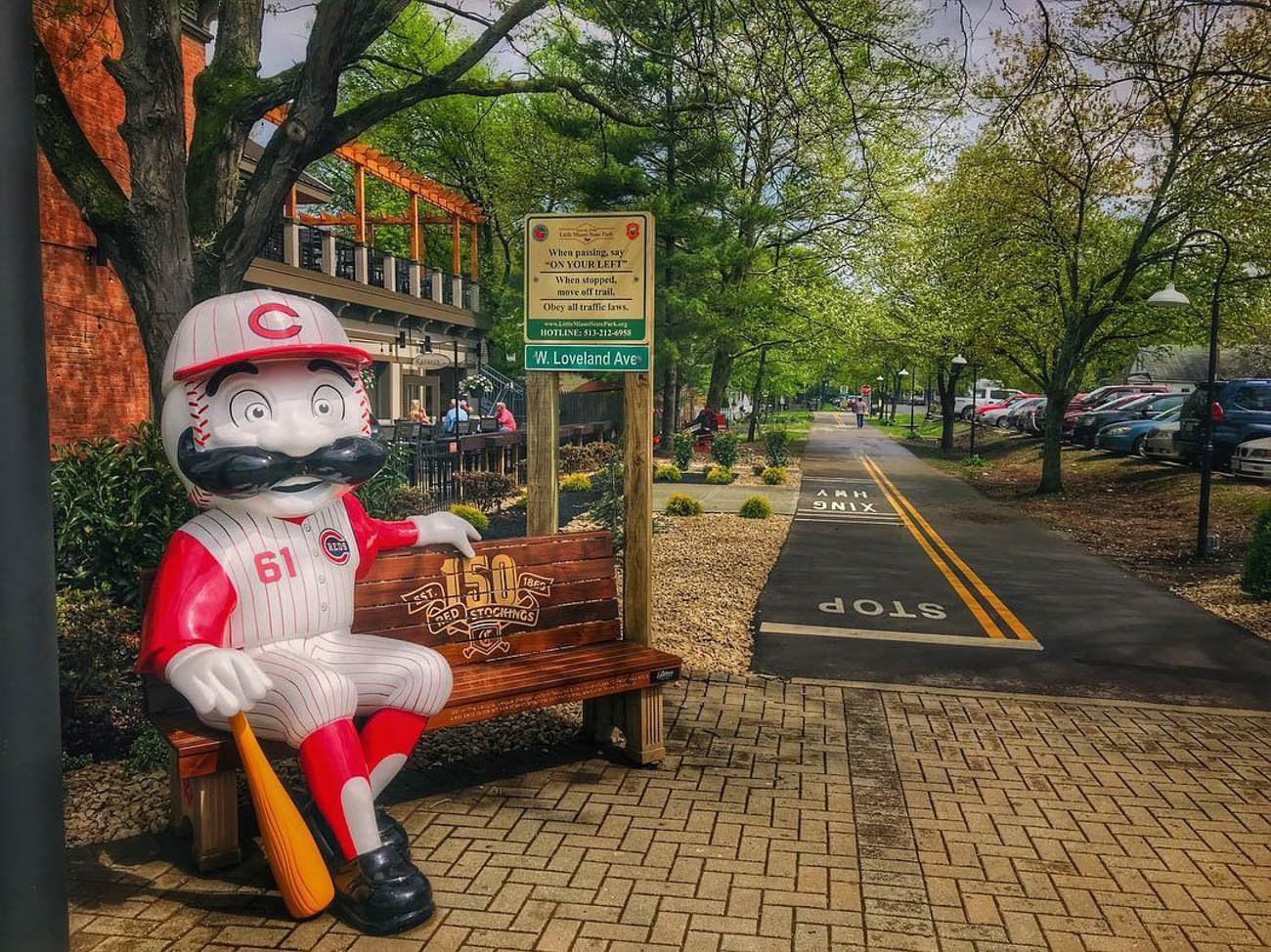 Mr. Redlegs greets bike riders with a smile. / Location: Bike Path in Downtown Loveland / Uniform: 1961 / Image courtesy of Instagram user @dbradle2   // Published: 5.14.19