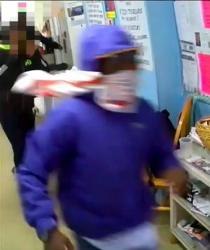 Masked man pepper sprays staffer at Casa Ruby LGBT Community Center. (MPD)
