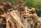 Spc. Justin Meagher, a Soldier with the 724th Engineer Battalion, operates a chain saw to cut up large debris at Saxon Harbor in Iron Co. Aug. 9, 2016, as part of flood recovery operations.