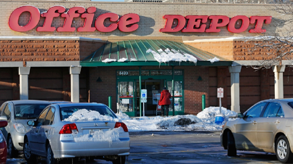 A customer enters an Office Depot store in the Hyde Park neighborhood of Chicago, Thursday, March 13, 2014. (AP Photo/Charles Rex Arbogast)