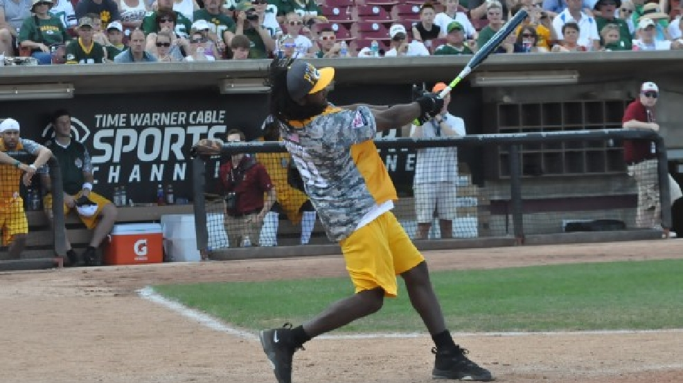 Green Bay Packers' Davon House swings during the Donald Driver Charity Softball Game, June 16, 2013, at Fox Cities Stadium in Grand Chute. (WLUK/Jake Timm)