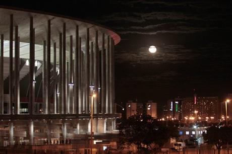 View of the National Stadium with moonrise after the third place finish World Cup match between Brazil and the Netherlands, outside the National Stadium in Brasilia, Brazil, Saturday, July 12, 2014.