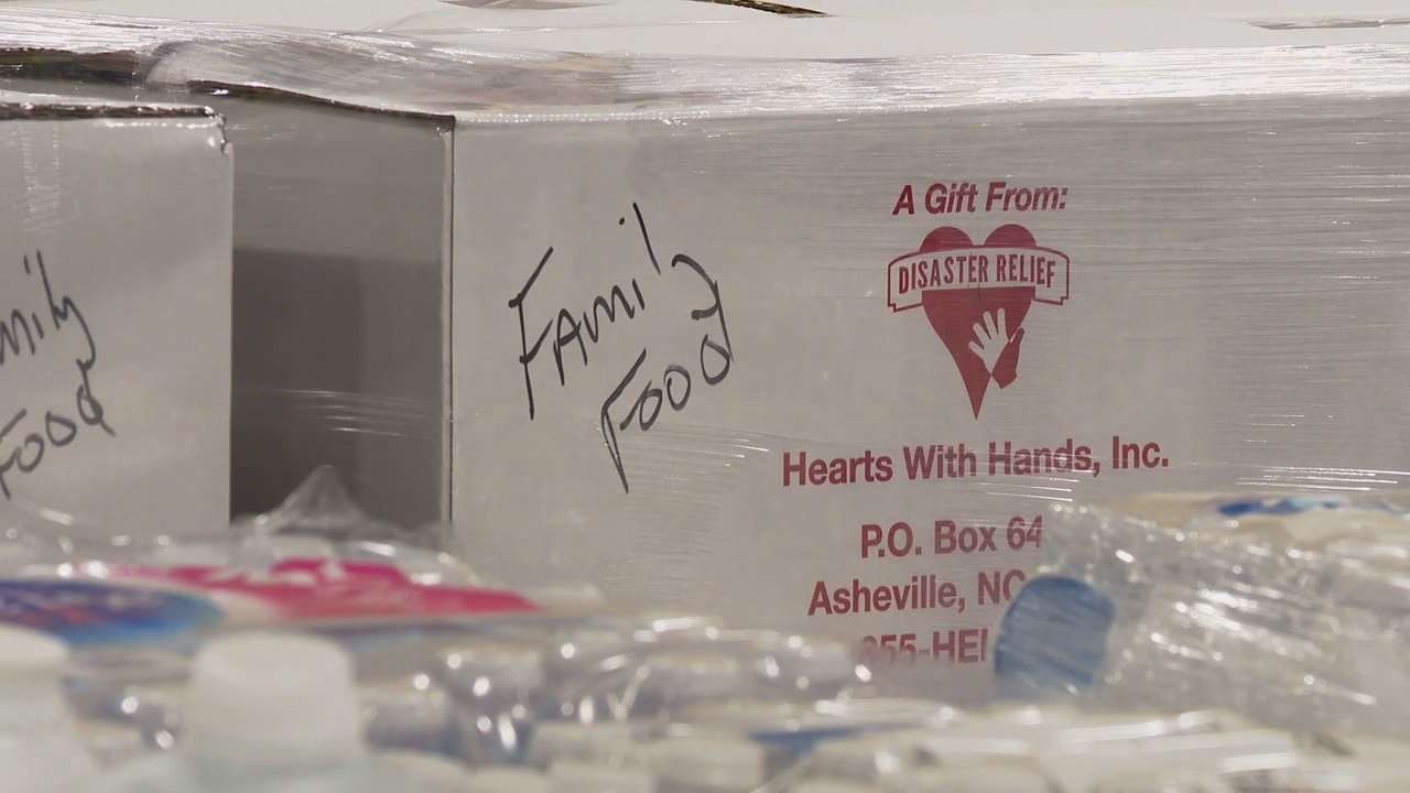 Hearts With Hands loaded a truck with supplies Thursday to take to Orange Beach, Alabama. (Photo credit: WLOS staff)