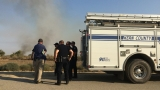 Southwest Bakersfield brush fire contained, one man in custody