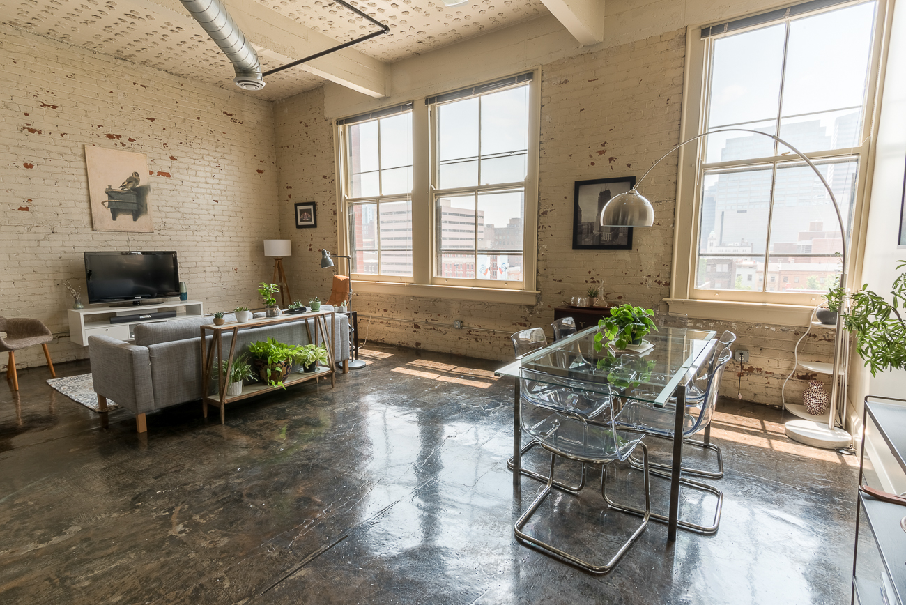 Hale Justis Lofts / DESCRIPTION: Industrial apartments with beautiful stained concrete floors, exposed brick, high ceilings, large floor plans, and tall windows in an old building at the precipice of OTR and Downtown. / APARTMENTS START AT: $1200 per month / ADDRESS: 20 E. Central Parkway / PHONE: (513) 646-7508 / IMAGE: Phil Armstrong, Cincinnati Refined // Published: 1.17.18