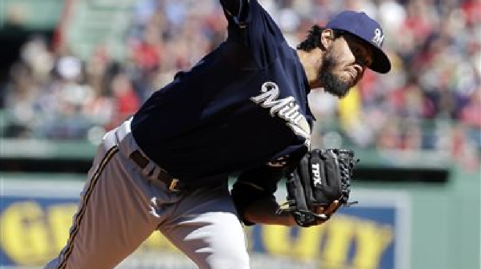 Milwaukee Brewers' Yovani Gallardo delivers a pitch against the Boston Red Sox in the first inning of a baseball game Sunday, April 6, 2014, in Boston. (AP Photo/Steven Senne)