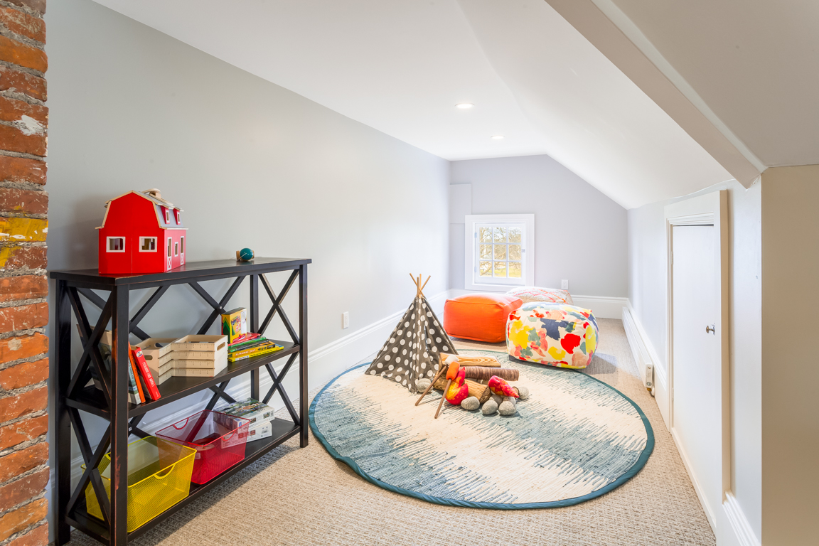 The spacious attic is perfect for a home office, theater or playroom.
