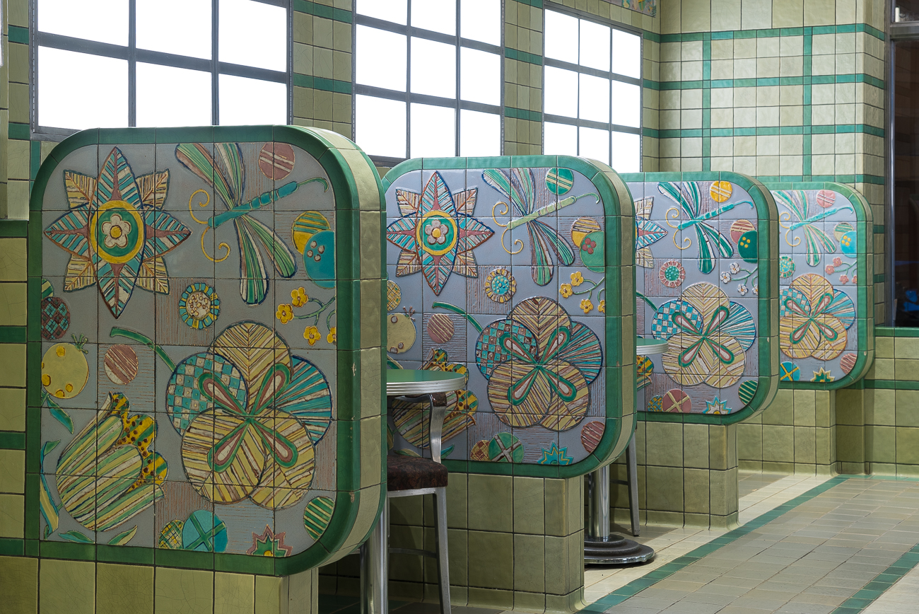 Rookwood tile partitions inlaid with colorful floral and dragon fly designs provide a bit of privacy for two people enjoying ice cream. / Image: Phil Armstrong, Cincinnati Refined // Published: 1.7.19