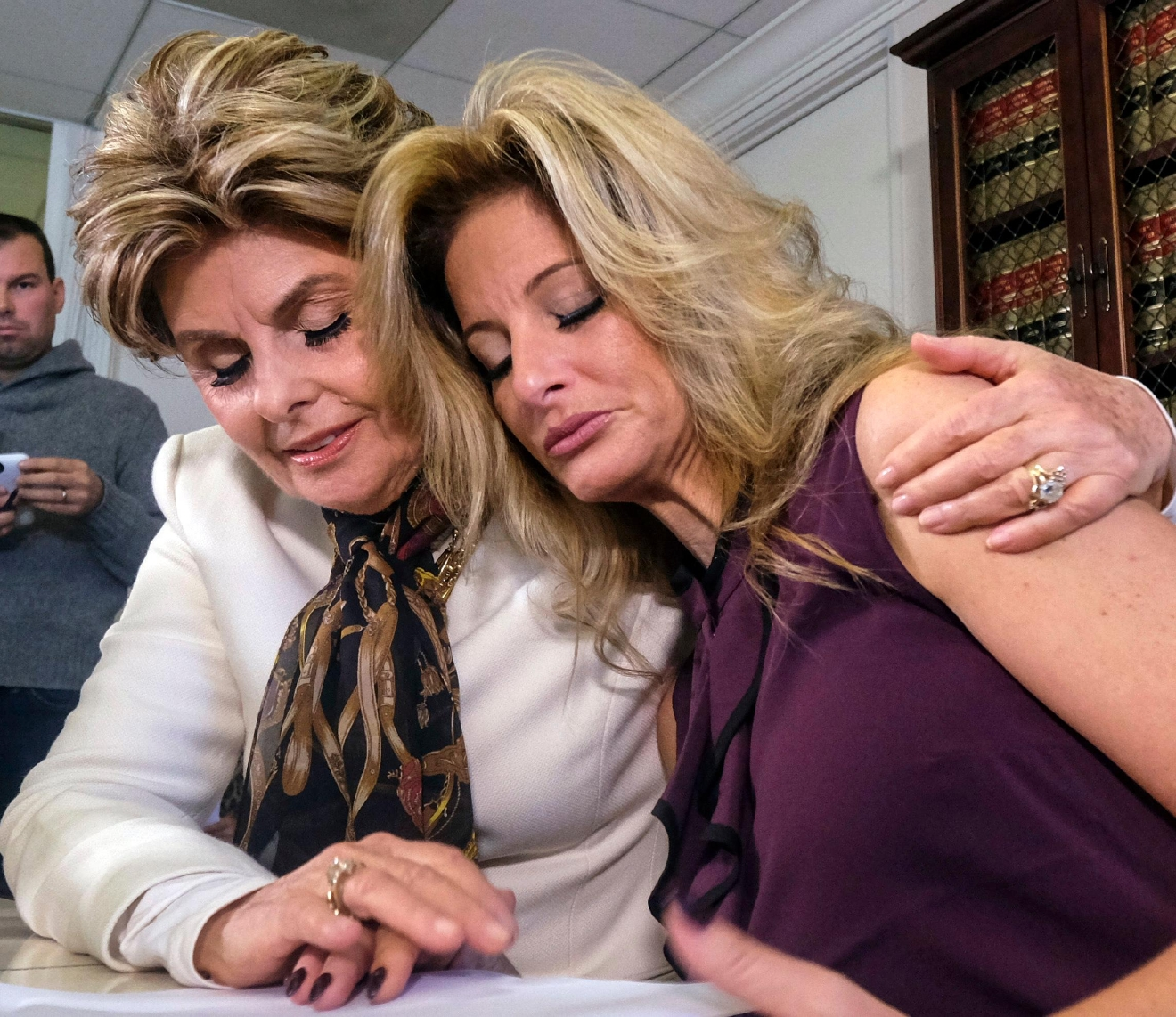 Attorney Gloria Allred, left, comforts Summer Zervos during a news conference in Los Angeles, Friday Oct. 14, 2016.  (AP Photo/Ringo H.W. Chiu)