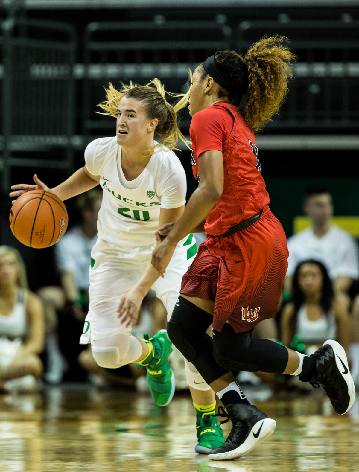 Oregon Ducks guard Sabrina Ionescu (#20) dribbles past Cardinals guard Chastadie Barrs. The Oregon Ducks Women's basketball team won their season opener against the Lamar Cardinals 84-67.  Photo by Austin Hicks, Oregon News Lab