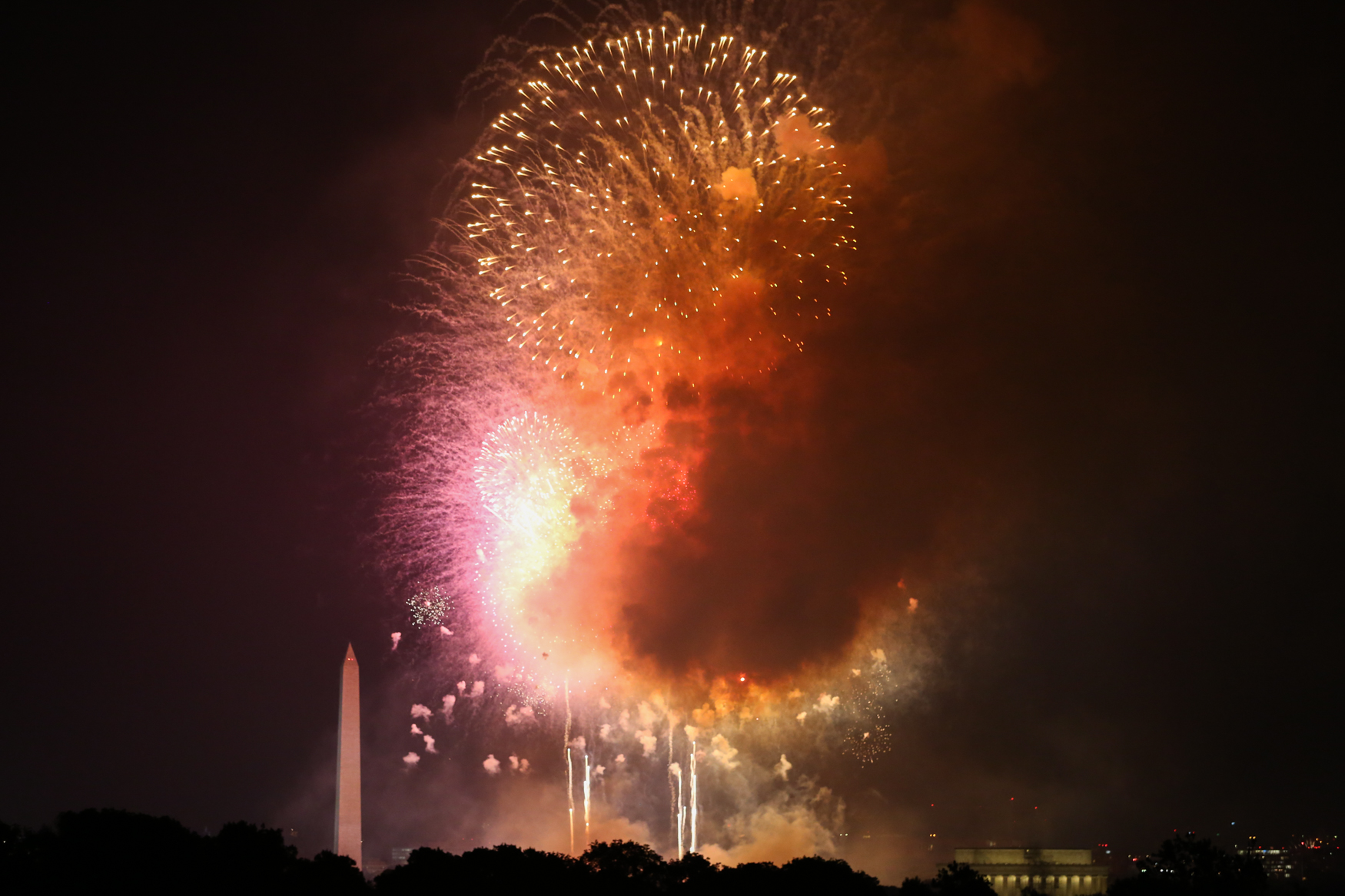 The D.C. skyline was illuminated for the annual Fourth of July fireworks show. Although thousands descended upon the National Mall, some of the best views came from the rooftops of Arlington, Virginia. (Amanda Andrade-Rhoades/DC Refined)