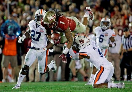 Auburn's Jermaine Whitehead (9) trips Florida State's Kelvin Benjamin after a catch during the second half of the NCAA BCS National Championship college football game Monday, Jan. 6, 2014, in Pasadena, Calif.