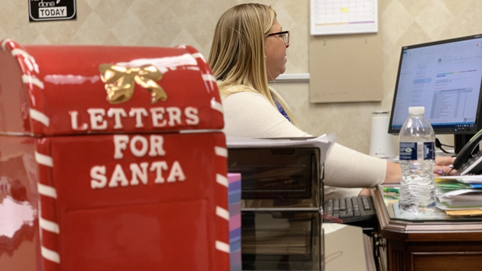 saginaw postal workers play santas little helpers