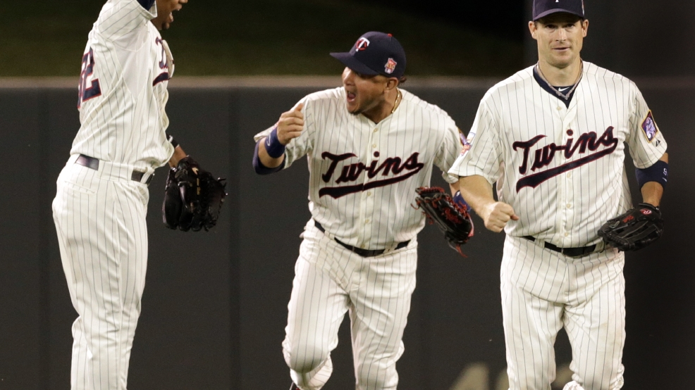 Minnesota Twins outfielders Aaron Hicks, left, Oswaldo Arcia, center and Josh Willingham celebrate the Twins 6-4 win over the Milwaukee Brewers in a baseball game, Wednesday, June 4, 2014, in Minneapolis. Arcia hit a three-run home run in the fourth inning and Willingham scored the winning run in the eighth. (AP Photo/Jim Mone)