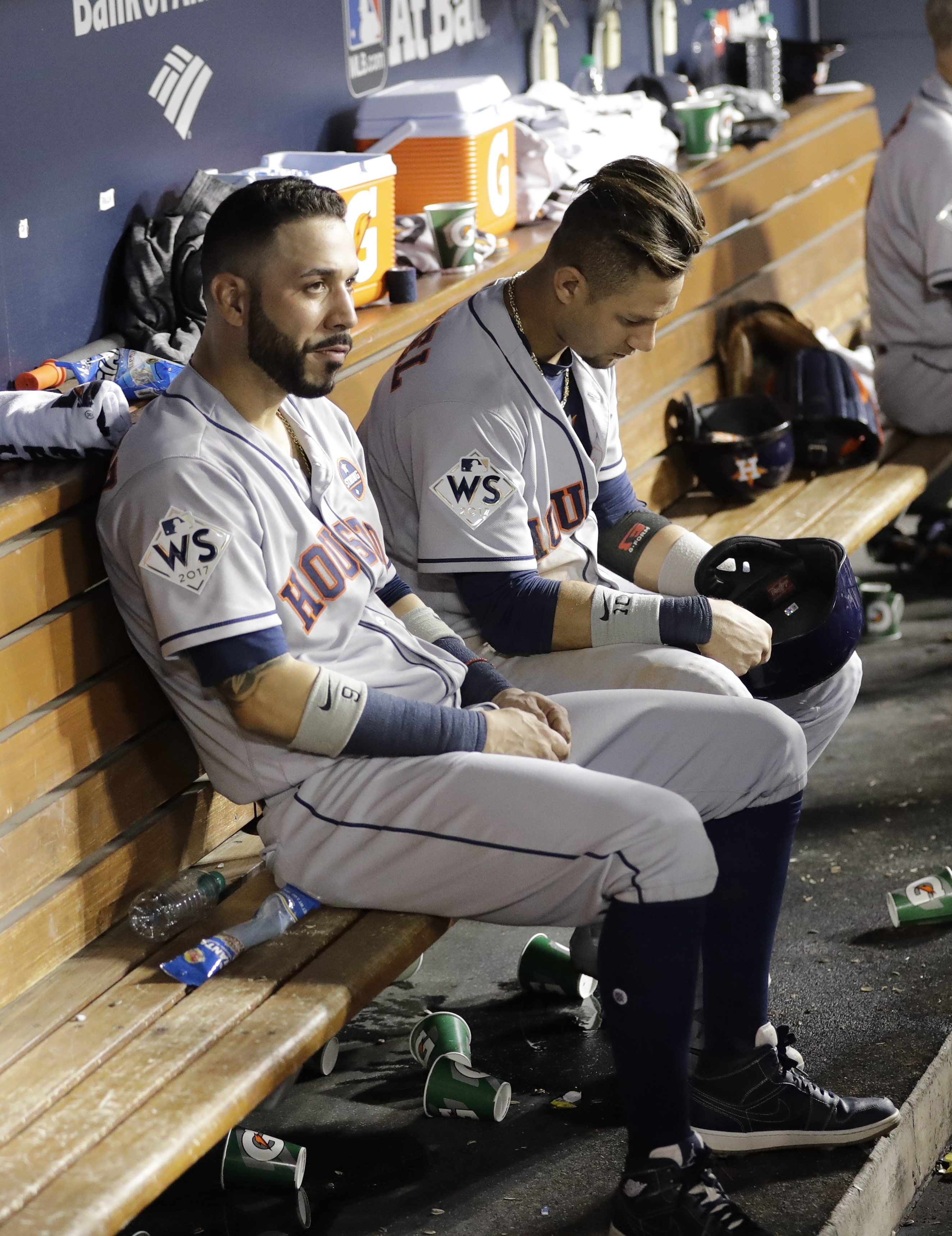Houston Astros' Yuli Gurriel and Marwin Gonzalez sit on the bench during the ninth inning of Game 1 of baseball's World Series against the Los Angeles Dodgers Tuesday, Oct. 24, 2017, in Los Angeles. (AP Photo/David J. Phillip)