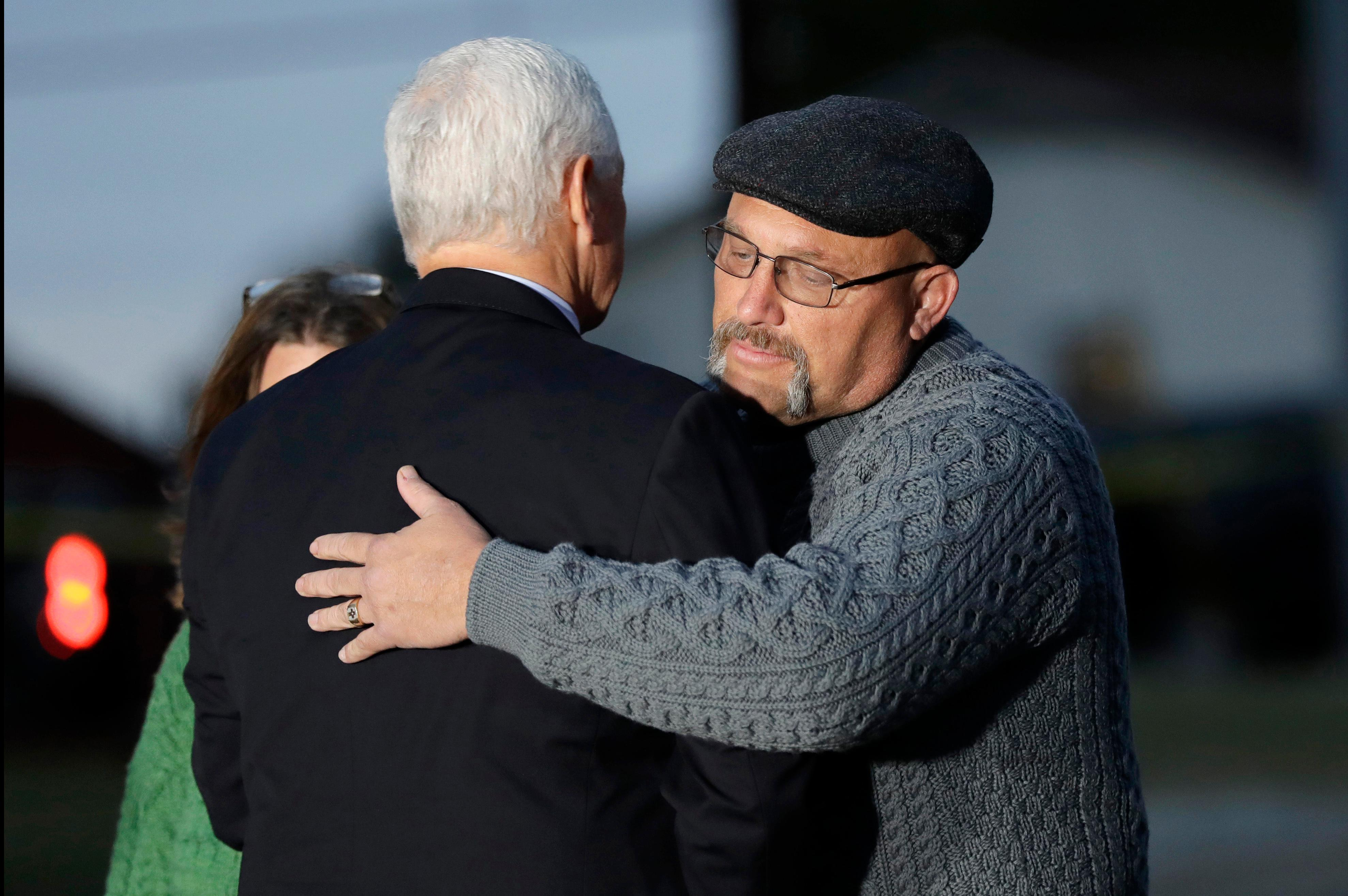 Vice President Mike Pence hugs Pastor Frank Pomeroy outside the Sutherland Spring Baptist Church during a stop, Wednesday, Nov. 8, 2017, in Sutherland Springs, Texas. A man opened fire inside the church in the small South Texas community on Sunday, killing and wounding many. Pomeroy's daughter was killed in the shooting. (AP Photo/Eric Gay)