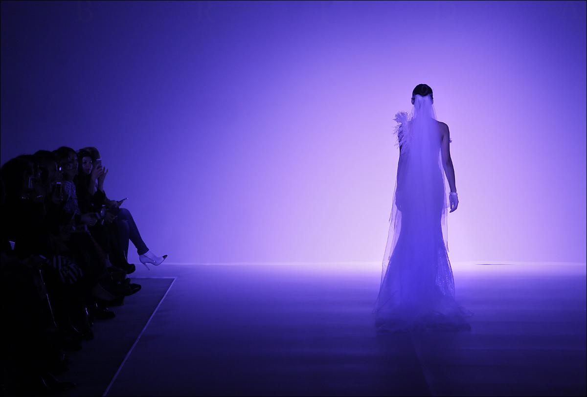 A model presents a creation by Taiwanese fashion designer Brian Chen during the Fall/Winter fashion week in Hong Kong, Tuesday, Jan. 19, 2016. (AP Photo/Vincent Yu)