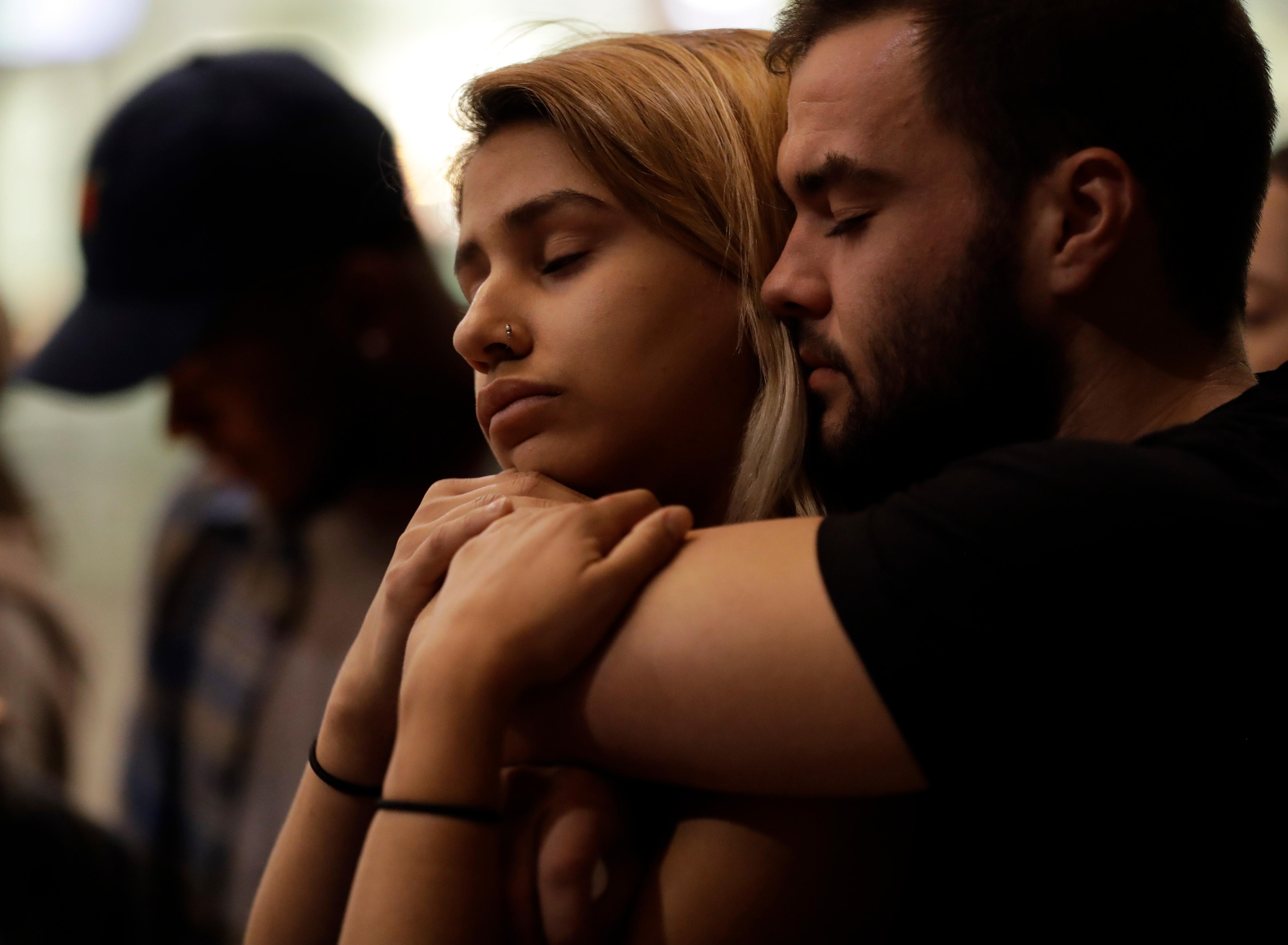 University of Nevada Las Vegas students Raymond Lloyd, right, and Karla Rodriguez take part in a vigil Monday, Oct. 2, 2017, in Las Vegas. A gunman on the 32nd floor of the Mandalay Bay casino hotel rained automatic weapons fire down on the crowd of over 22,000 at an outdoor country music festival Sunday. (AP Photo/Gregory Bull)