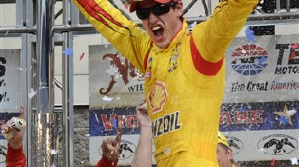 Joey Logano celebrates winning the NASCAR Sprint Cup Series auto race at Texas Motor Speedway Monday, April 7, 2014, in Fort Worth, Texas. (AP Photo/Larry Papke)