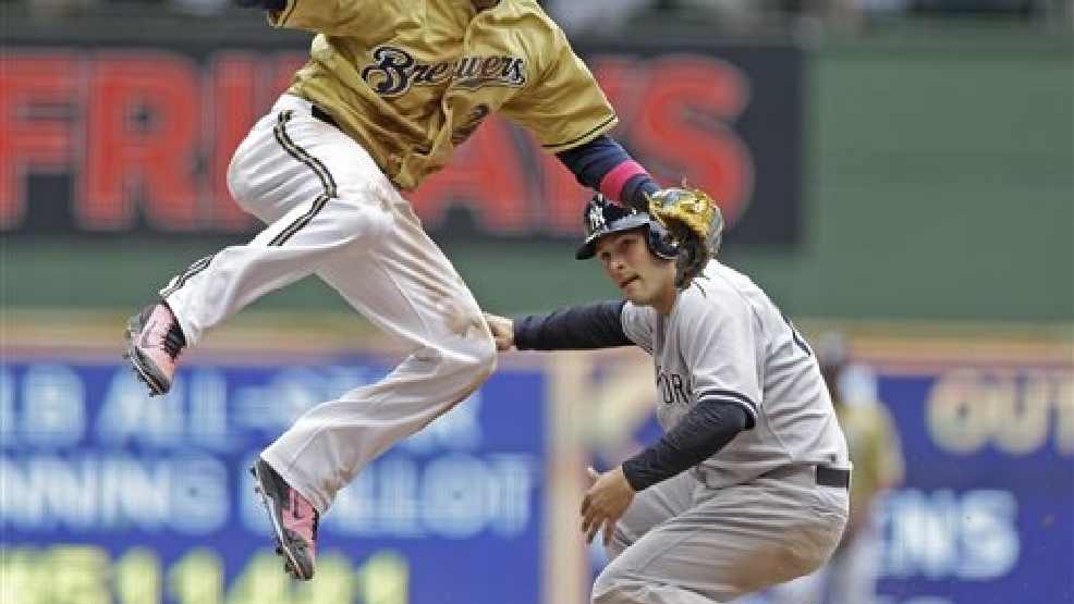 Milwaukee Brewers' Rickie Weeks, left, forces out New York Yankees' John Ryan Murphy at second base during the eighth inning of a baseball game Sunday, May 11, 2014, in Milwaukee. (AP Photo/Jeffrey Phelps)