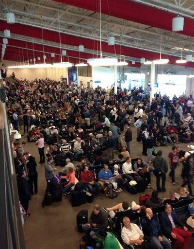n this photo provided by Tory Belleci which has been authenticated based on its contents and other AP reporting, people wait in Los Angeles International Airport, Friday, Nov. 1, 2013.