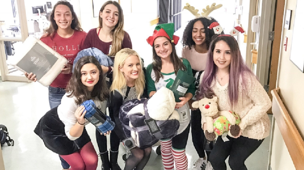high school seniors give the gift of christmas to patients at local hospital