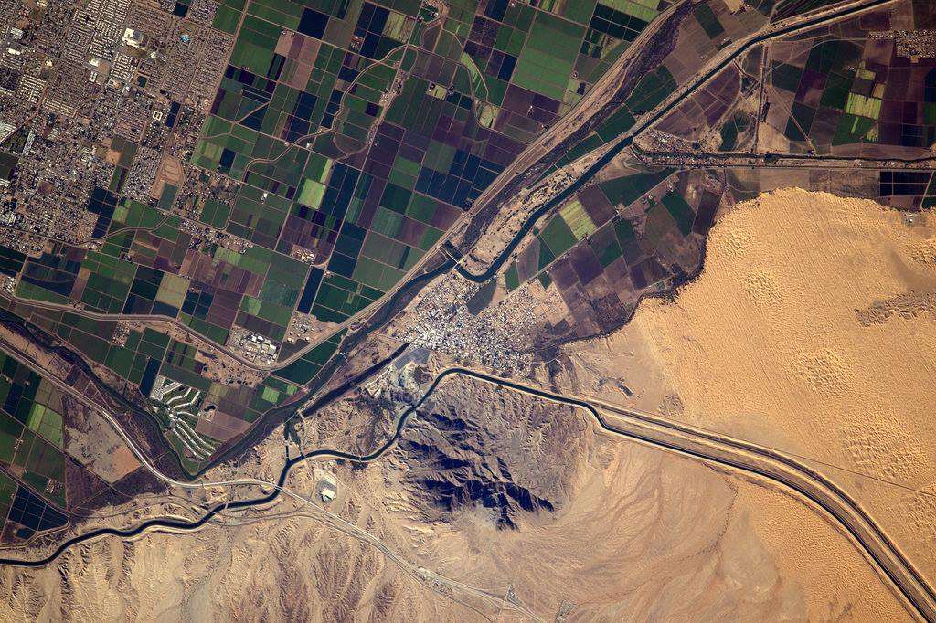 Land-use and the impact of man on the environment are two critical topics. City, irrigated fields and desert in Arizona (Photo & Caption: Thomas Pesquet // NASA)